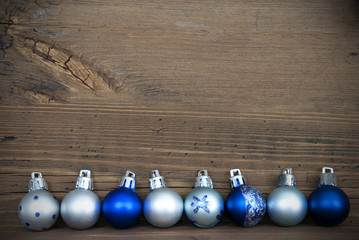 Christmas Balls Lying on Wood with Copy Space