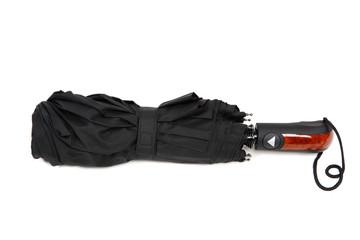 Modern black umbrella on white background.