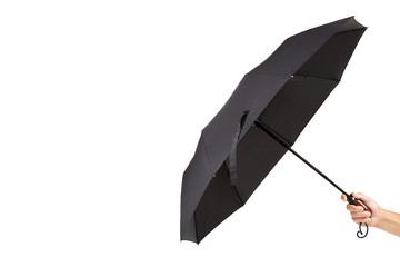 Modern black umbrella in hand on white background.