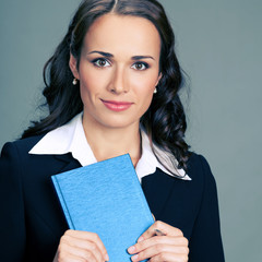 Businesswoman with notepad or organizer