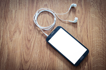 white earphones attached to smartphone