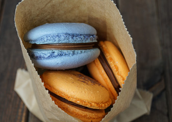 macaroons in a backery paper bag
