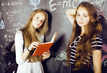 back to school after summer vacations, two teen girls in