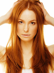 beauty young woman with red hair isolated