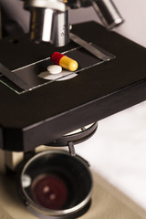 Science lab research safe of new drugs, microscope and pills