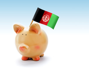 Piggy bank with national flag of Afghanistan