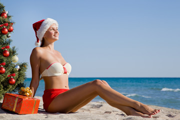 Young girl celebrates Christmas on the beach