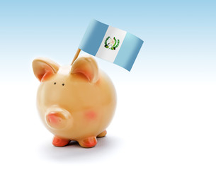 Piggy bank with national flag of Guatemala