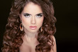 Beautiful model with curly brown hair and fashion earrings isola