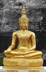 Golden Buddha statue stucco sitting meditation.