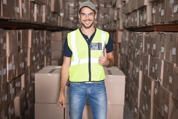 Warehouse worker smiling at camera
