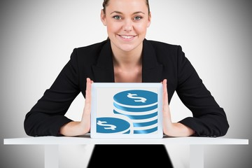Composite image of businesswoman showing tablet pc