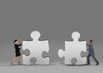Composite image of business team standing and pushing
