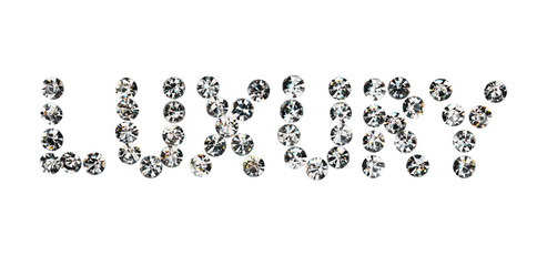 Word  luxury  made by ​​with rhinestones