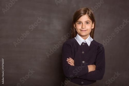 Cute pupil smiling at camera - 70716307