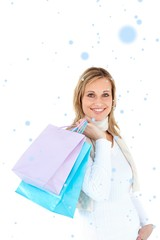 Handsome woman holding shopping bags