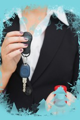 Composite image of woman holding key and small car in her palm