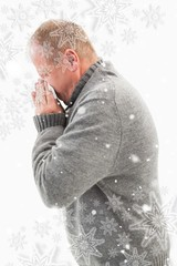 Sick mature man blowing his nose