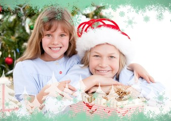 Composite image of adorable childrens celebrating christmas