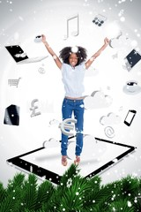 Composite image of cheerful woman jumping on a tablet pc