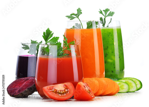 canvas print picture Glasses with fresh vegetable juices isolated on white