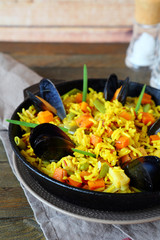 paella with mussels in a pan