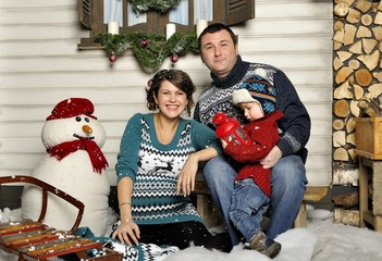Friendly family with pregnant woman during Christmas time