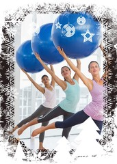 Fitness class doing pilates exercise with fitness balls