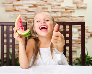 Little girl eating an watermelon
