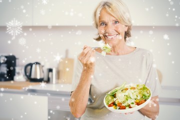 Composite image of smiling woman eating salad