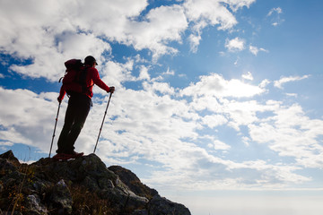 Hiker standing on the top of a mountain