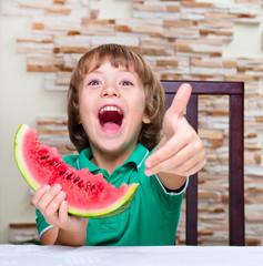 Little boy eating an watermelon