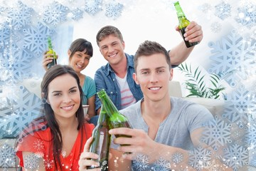 Group of friends celebrating by clinking bottles together