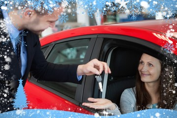 Composite image of customer receiving car keys