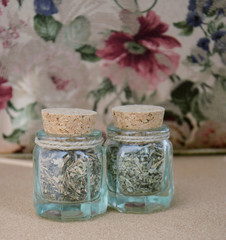 Two small bottles with dried herbs