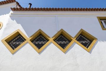 barred windows in Evora, Portugal