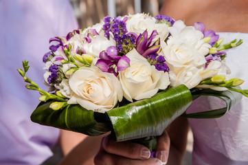 Wedding bouquet of beautiful purple flowers