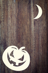 Halloween pumpkin over wooden background