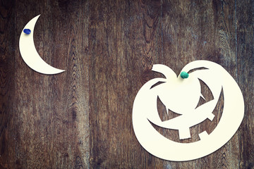 Halloween symbol pumpkin over wooden background