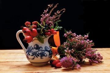Vase with wild berries
