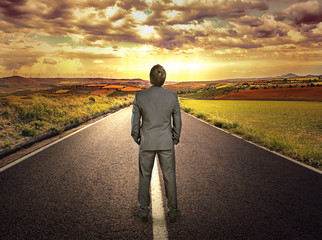 Businessman on the road. Concept of straight path of success