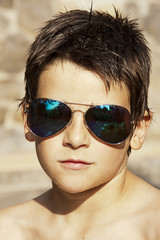 Portrait of boy in the foreground with sunglasses