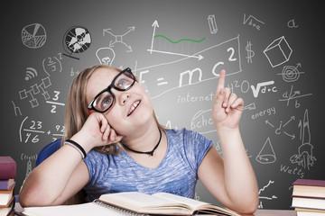 portrait of girl on desk at school