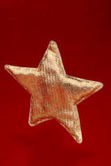 Christmas gold star on red background.