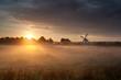 misty sunrise and Dutch windmill