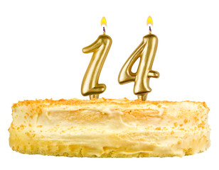 birthday cake with candles number fourteen isolated on white