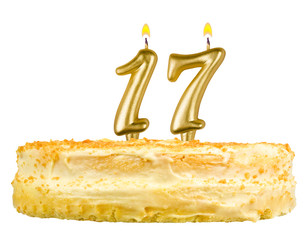 birthday cake with candles number seventeen isolated on white