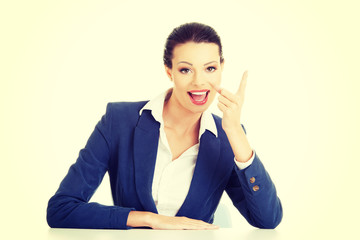 Business woman pointing with finger to empty copy space