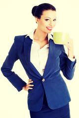 Business woman with big mug