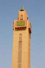 Mosque minaret against a blue sky